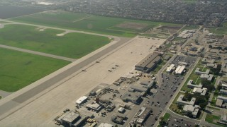 AX0016_098 - 5K stock footage aerial video of military helicopters parked at Los Alamitos Army Airfield, California