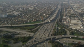 AX0017_027 - 5K stock footage aerial video of following Interstate 110 along residential area, Gardena, California