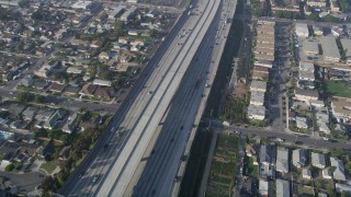 AX0017_028 - 5K stock footage aerial video of following Interstate 110 along residential area, Gardena, California