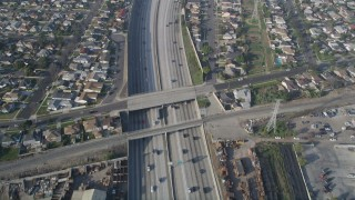 AX0017_030 - 5K stock footage aerial video of following Interstate 110 along residential area, Gardena, California
