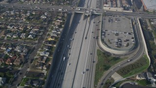 AX0017_031 - 5K stock footage aerial video of following Interstate 110 along residential area, Gardena, California