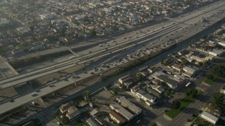 AX0017_034 - 5K stock footage aerial video of following Interstate 110 with heavy traffic through neighborhoods, Westmont, California