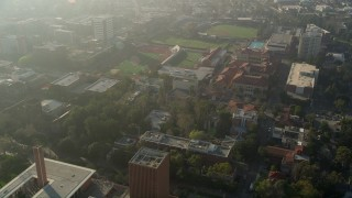 AX0017_043 - 5K stock footage aerial video of University of Southern California campus and Cromwell Field, California