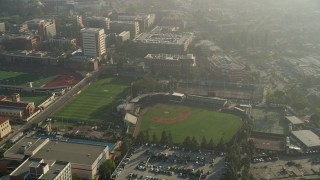 AX0017_044 - 5K stock footage aerial video of orbiting a baseball field, University of Southern California