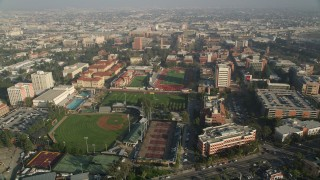 AX0017_045 - 5K stock footage aerial video of baseball field and Cromwell Field, University of Southern California