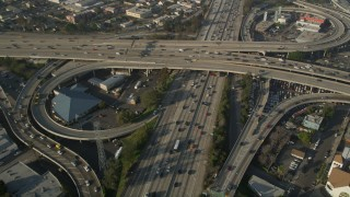 AX0017_060 - 5K stock footage aerial video of following Interstate 110 over the 10 interchange, Downtown Los Angeles
