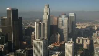 AX0017_063E - 5K stock footage aerial video orbiting skyscrapers around US Bank Tower, Downtown Los Angeles, California