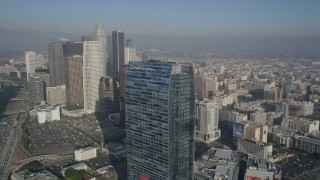 AX0017_071 - 5K stock footage aerial video of orbiting Ritz Carlton revealing skyscrapers, Downtown Los Angeles
