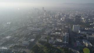 AX0017_075 - 5K stock footage aerial video of flying toward Koreatown buildings and high-rises, Central Los Angeles, California