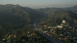 AX0017_085 - 5K stock footage aerial video of Highway 101 through the Hollywood Hills, Hollywood, California