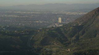 AX0017_087 - 5K stock footage aerial video of Warner Brothers Studio from Hollywood Hills, Burbank, California