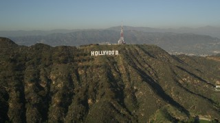 AX0017_088E - 5K stock footage aerial video approach and orbit the Hollywood Sign, Hollywood, California