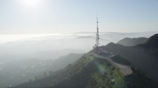 AX0017_089 - 5K stock footage aerial video of orbiting the Hollywood Sign, Hollywood, California