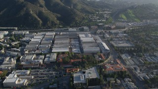 AX0017_101 - 5K stock footage aerial video of orbiting Warner Brothers Studios, Burbank, California