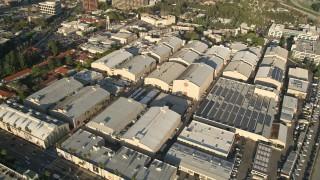 AX0017_101E - 5K stock footage aerial video of orbiting Warner Brothers Studios, Burbank, California