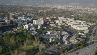 AX0017_103 - 5K stock footage aerial video of approaching Walt Disney Company studios, Burbank, California