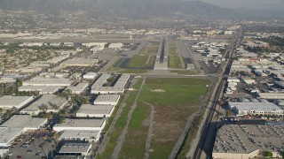 AX0017_111 - 5K aerial stock footage video of approaching Bob Hope International Airport, Burbank, California