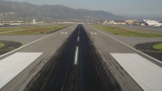 AX0017_112 - 5K stock footage aerial video of approach runway at Bob Hope International Airport, Burbank, California