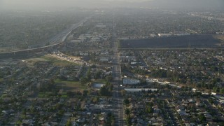 AX0017_115 - 5K stock footage aerial video of approaching highways and residential neighborhoods, Sun Valley, California