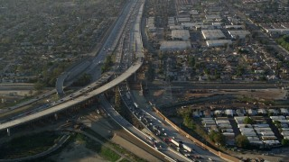AX0017_116 - 5K stock footage aerial video of following interstates with heavy traffic, Sun Valley, California, sunset