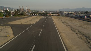 AX0017_120 - 5K stock footage aerial video of runway at Whiteman Airport while landing, Pacoima, California, sunset