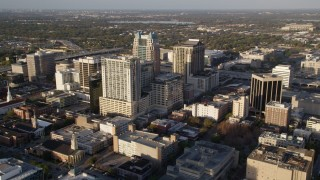 AX0018_005 - 5K stock footage aerial video approach SunTrust Center in Downtown Orlando at sunrise in Florida