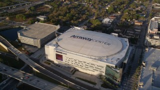 AX0018_007 - 5K stock footage aerial video approach Amway Center in Downtown Orlando at sunrise, Florida