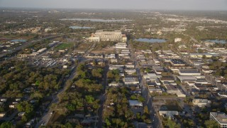 AX0018_008 - 5K stock footage aerial video tilt up from neighborhood, reveal Citrus Bowl in Orlando, Florida at Sunrise