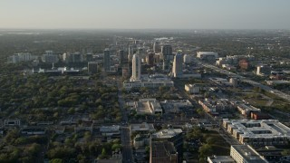 AX0018_013 - 5K stock footage aerial video orbiting Downtown Orlando at sunrise in florida