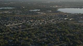 AX0018_024 - 5K stock footage aerial video of suburban Orlando neighborhood beside Lake Baldwin at sunrise, Florida
