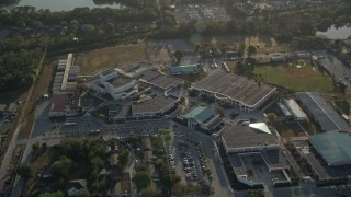 AX0018_026 - 5K stock footage aerial video of approaching a high school in Orlando, Florida at sunrise