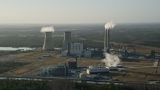 AX0018_027 - 5K stock footage aerial video approach Stanton Energy Center power plant in Orlando at sunrise, Florida