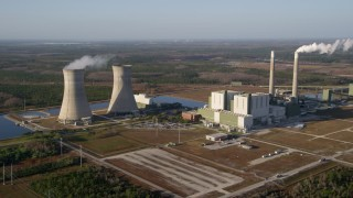 AX0018_028 - 5K stock footage aerial video of Stanton Energy Center power plant in Orlando at sunrise in Florida
