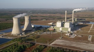 AX0018_029 - 5K stock footage aerial video flyby the Stanton Energy Center power plant in Orlando at sunrise, Florida