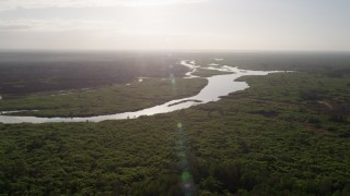 AX0018_040 - 5K stock footage aerial video of a slow approach to St. Johns River near Orlando at sunrise, Florida