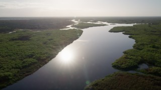 AX0018_042 - 5K stock footage aerial video fly over St. Johns River near Orlando at sunrise in Florida