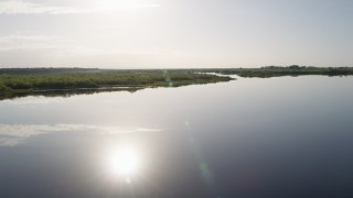 AX0018_044 - 5K stock footage aerial video fly low over St. Johns River near Orlando at sunrise in Florida
