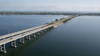 AX0018_067 - 5K stock footage aerial video flyby Melbourne Causeway over the Indian River in Florida