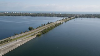 AX0018_068 - 5K stock footage aerial video flyby Melbourne Causeway with light traffic over the Indian River in Florida