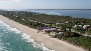 AX0018_071 - 5K stock footage aerial video flyby beach motel in Melbourne Beach, Florida
