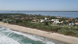 AX0018_073 - 5K stock footage aerial video of a small beachfront neighborhood in Melbourne Beach, Florida