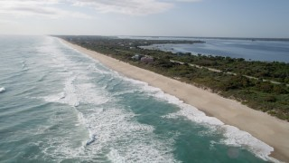 AX0018_078 - 5K stock footage aerial video flyby deserted shore of Melbourne Beach, Florida