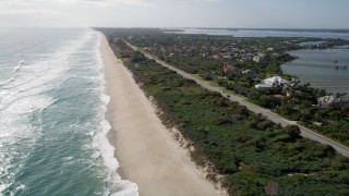 AX0018_079 - 5K stock footage aerial video fly over sandy shore of Melbourne Beach in Florida