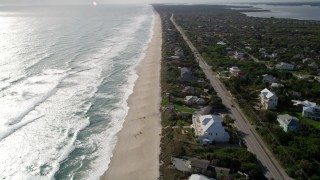 AX0018_082 - 5K stock footage aerial video fly over Melbourne Beach homes by the beach and ocean in Florida
