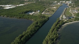 AX0018_095 - 5K stock footage aerial video pan and reveal Harbor Branch Ocean Institute at Fort Pierce, Florida