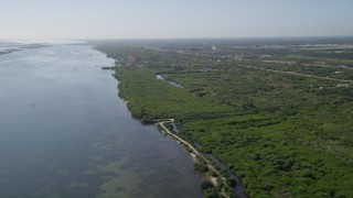 AX0018_096 - 5K stock footage aerial video of shoreline of the Indian River by Fort Pierce, Florida