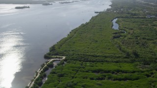 AX0018_097 - 5K stock footage aerial video flyby bank of the Indian River in Florida