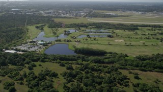 AX0018_099 - 5K stock footage aerial video approach the Fairwinds Golf Course in Fort Pierce, Florida