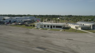 AX0018_102 - 5K stock footage aerial video of approaching the office at St. Lucie County International Airport in Florida