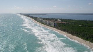 AX0019_002 - 5K stock footage aerial video approach beachside apartment buildings in Port St. Lucie, Florida